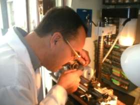 Gaetan Fortier (owner) making final adjustments on a timepiece